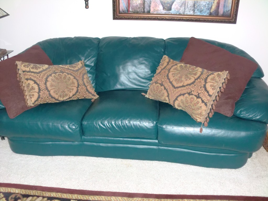 Really ugly Green Leather Sofa