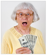 older woman holding cash