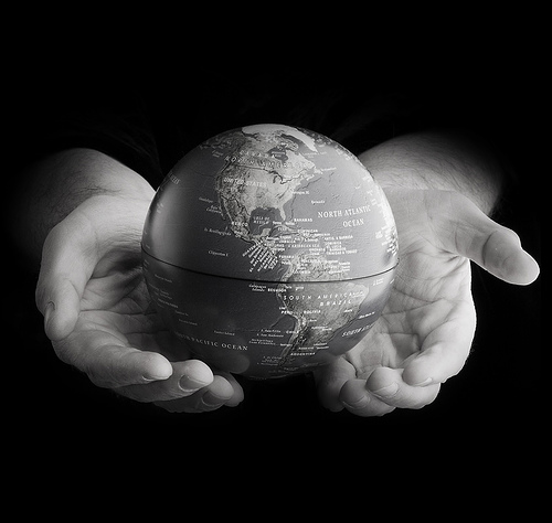 hands with globe