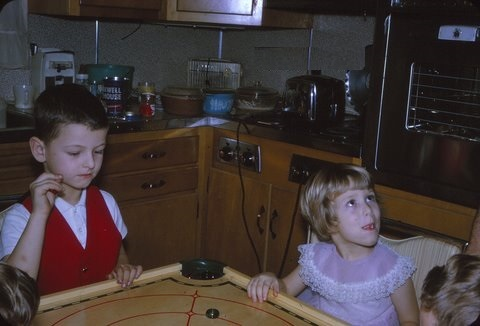 Playing with the Carrom Board around Grandma's Table